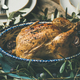 Whole roasted chicken decorated with olive tree branch, selective focus - PhotoDune Item for Sale