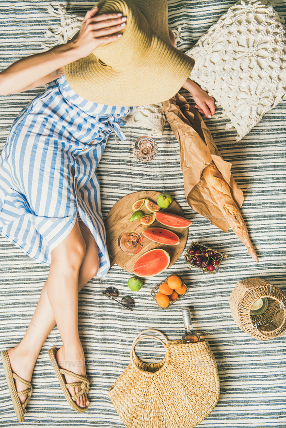 Woman in hat and dress with wine, fruits and baguette - Stock Photo - Images