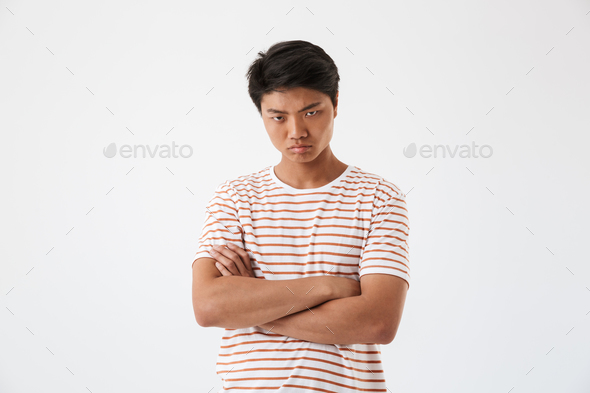 Portrait of a disappointed young asian man - Stock Photo - Images