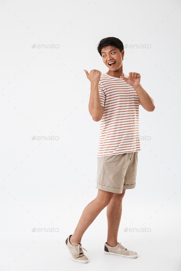 Full length portrait of a happy young asian man - Stock Photo - Images