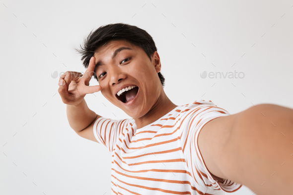 Close up portrait of a happy young asian man - Stock Photo - Images