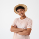 Portrait of a smiling young asian man in hat - PhotoDune Item for Sale