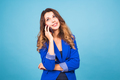 Happy smiling successful businesswoman with cell phone, on blue background - PhotoDune Item for Sale