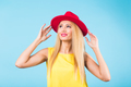 Portrait of happy cheerful smiling young beautiful blond woman on blue background - PhotoDune Item for Sale