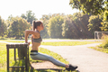 Young fit woman exercising by doing push-ups outdoors - PhotoDune Item for Sale