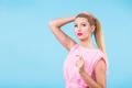 Young woman fashion lookbook model studio portrait on blue background. - PhotoDune Item for Sale