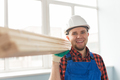 Portrait of handsome male builder laughing infront of window - PhotoDune Item for Sale