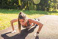 Fitness woman doing push-ups during outdoor cross training workout - PhotoDune Item for Sale