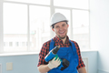 Happy caucasian male builder with drill wearing white helmet. - PhotoDune Item for Sale