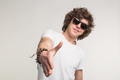 Portrait of cool guy in sunglasses stretching his hand in white t-shirt. - PhotoDune Item for Sale