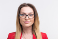 Portrait of young freckled woman wearing glasses against white background - PhotoDune Item for Sale