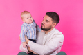 Baby in the daddy hands. Pink background. - PhotoDune Item for Sale
