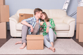 Family with boxes and holding flat keys. - PhotoDune Item for Sale