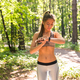 Young athlete woman checking fitness progress on her smart watch - PhotoDune Item for Sale