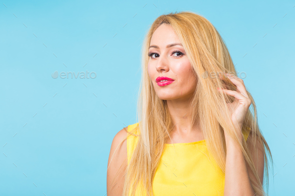 Beautiful woman with long straight blond hair. Fashion model - Stock Photo - Images
