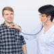 Man and doctor with stethoscope listening to heartbeat over white background - PhotoDune Item for Sale