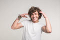 Happy handsome young man with moving arms on white background - PhotoDune Item for Sale