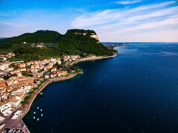 Aerial view of the coast of Lake Garda and a city in Italy. - Stock Photo - Images