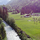 Aerial fly over a river in a landscape in the Alps - VideoHive Item for Sale