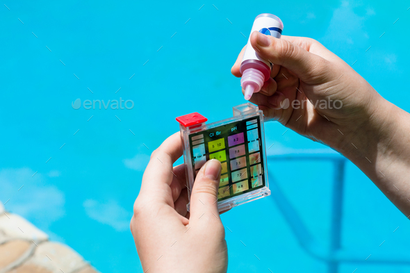 Addition of a chemical to pH meter for measure - Stock Photo - Images