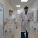 A Doctor and a Nurse Walk Along the Hospital Corridor To the Camera - VideoHive Item for Sale