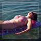 Girl Relaxing In The Sea - VideoHive Item for Sale