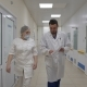 The Doctor Gives the Nurse a Job in the Hospital Corridor on His Way To the Ward - VideoHive Item for Sale
