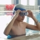 A Young Man in the Pool Wears Glasses for Scuba Diving - VideoHive Item for Sale