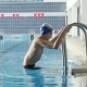 A Young Man Descends the Stairs To the Pool - VideoHive Item for Sale