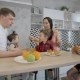 Multi-ethnic Family with Three Children Eating Dessert in the Kitchen - VideoHive Item for Sale