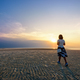 Woman strolling on the beach at Sunset - PhotoDune Item for Sale
