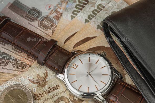 Watch and wallet on banknote - Stock Photo - Images
