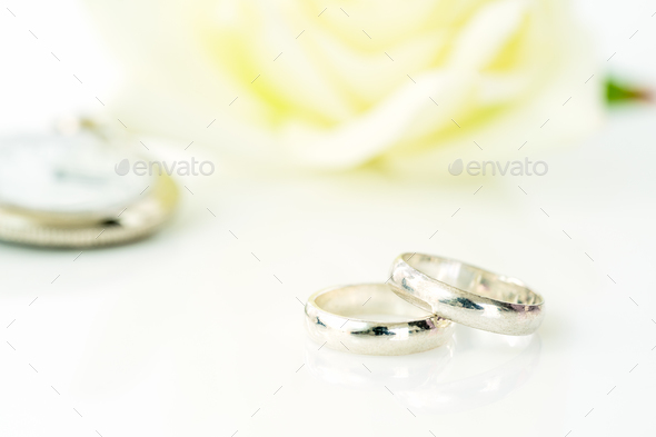 Wedding ring and White rose_ - Stock Photo - Images