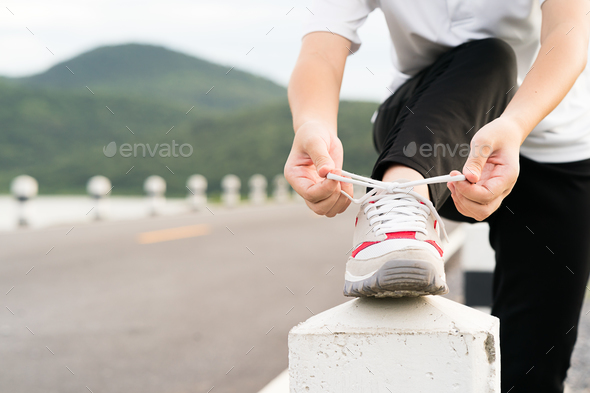 Woman tying shoelace his before starting running-2 - Stock Photo - Images