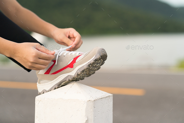 Woman tying shoelace his before starting running-4 - Stock Photo - Images