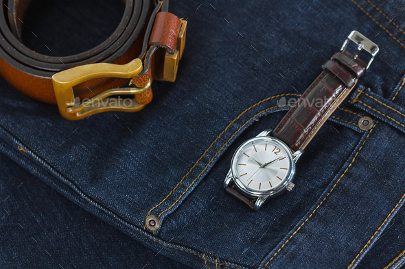 Wrist watch and leather belt on jeans-8 - Stock Photo - Images