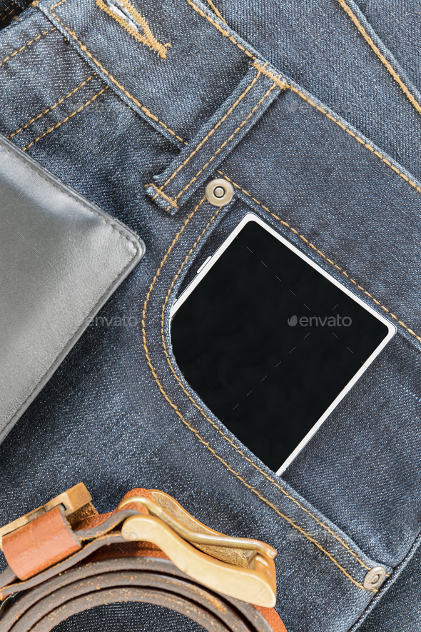 Wrist watch and smartphone on jeans - Stock Photo - Images