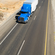 Big Blue Truck Hauling a Load of Freight down the Highway - PhotoDune Item for Sale