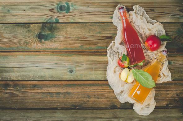 Apple cider vinegar and fresh apples - Stock Photo - Images