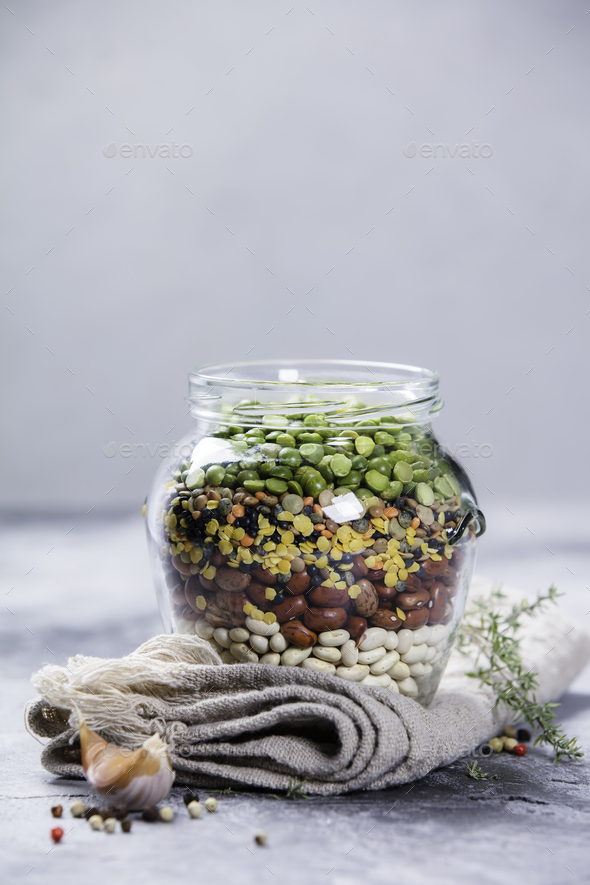 Legumes - lentils chickpeas beans and green peas - Stock Photo - Images