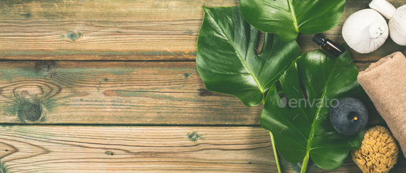 flat lay layout with monstera leaves and cosmetic care products - Stock Photo - Images