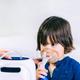 Boy using respiratonic inhaler - PhotoDune Item for Sale