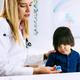 Pediatrician using finger pulse oximeter on little boy - PhotoDune Item for Sale