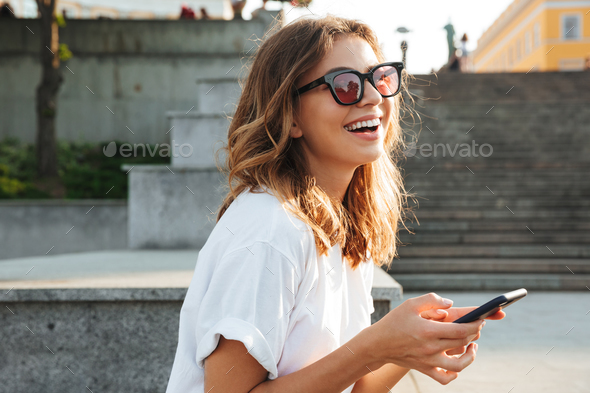Picture of european brunette woman wearing casual summer outfit - Stock Photo - Images