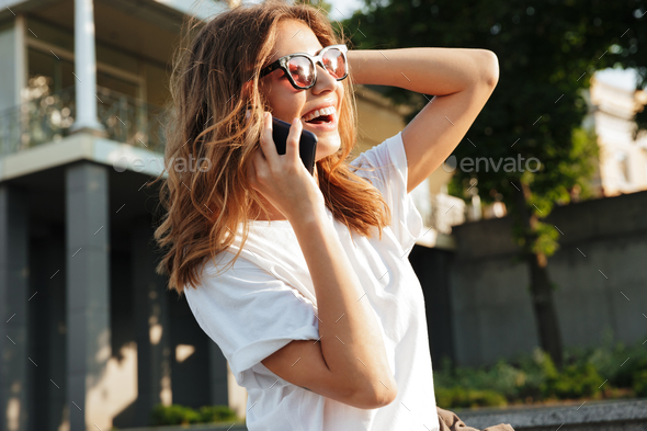 Image of beautiful happy woman wearing casual summer outfit and - Stock Photo - Images