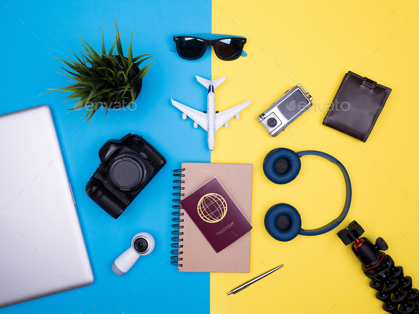 flat lay top view of traveler photographer accessories on yellow background - Stock Photo - Images