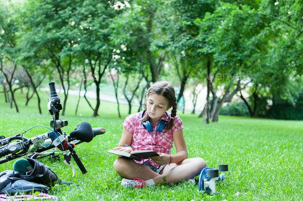 Girl reading a good book - Stock Photo - Images