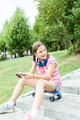 Girl having fun with her phone in the park - PhotoDune Item for Sale