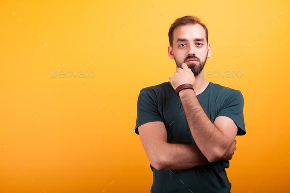 Serious handsmone man posing in studio - Stock Photo - Images
