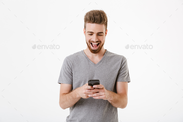 Handsome young man using mobile phone. - Stock Photo - Images